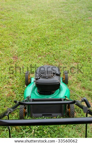stock-photo-lawn-mover-on-green-lawn-33560062.jpg