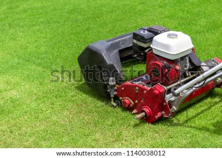 Lawn mower in football field. #1140038012