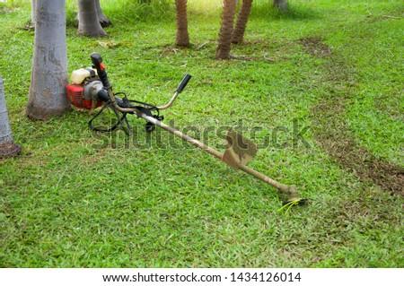 Lawn Mower in green field background   #1434126014