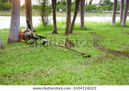 Lawn Mower in green field background   #1434126023