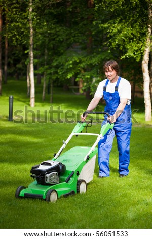 lawn mower man working on the backyard