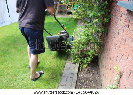 lawn mower mowing the lawn #1436844026