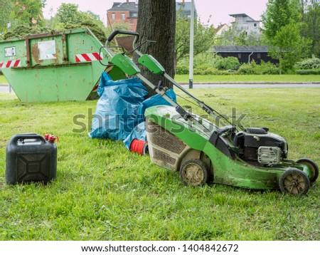 Lawnmower Green maintenance in a park #1404842672
