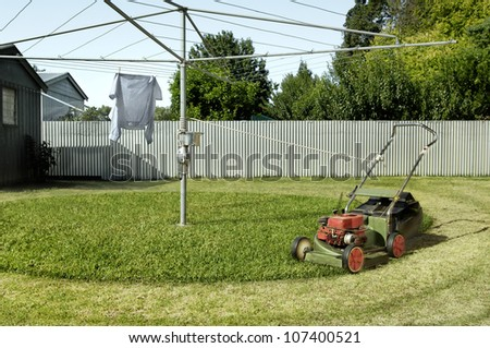 Lawnmower tied to a clothesline to create a clever and funny automatic lawnmowing invetnion.
