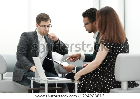 lawyer and a couple discussing the terms of the contract #1294963813