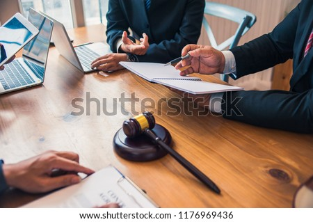 Lawyer are currently providing legal advice to clients.Legal planning #1176969436