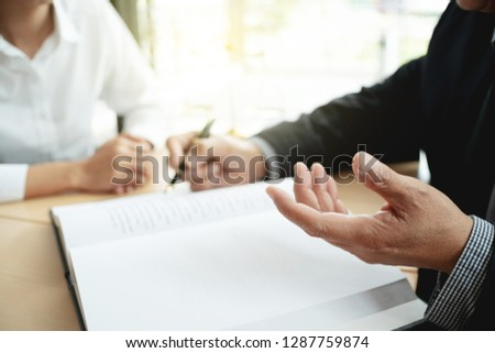lawyer consultant give an advice with client at law firm.