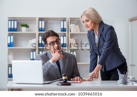 Lawyer discussing legal case with client - Shutterstock ID 1039665016