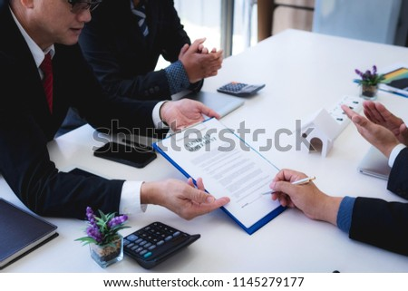 lawyer explain the documents contact of insurance of fire and theft a house at office desk. home protection, family, insurance.rent house concept . #1145279177