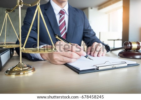 lawyer hand writes the document in court (justice, law).