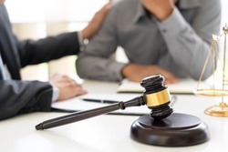 lawyer having meeting and consoling solution to his clients provide legal advice and trust commitment strain serious for problem,  justice and attorney concept