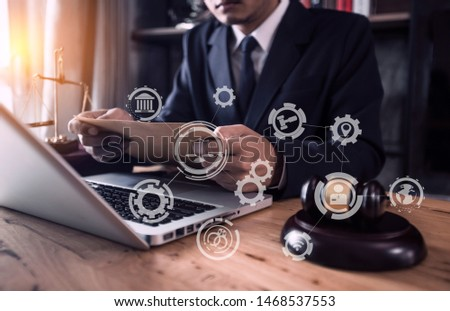 Lawyer holding the envelope and working on wood table at coffee with law interfaces icon. #1468537553