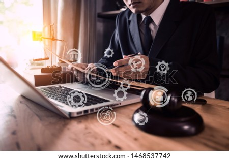 Lawyer holding the envelope and working on wood table at coffee with law interfaces icon. #1468537742