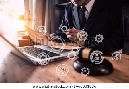 Lawyer holding the envelope and working on wood table at coffee with law interfaces icon. #1468831076