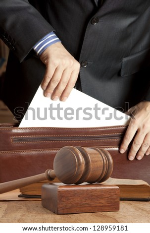 Lawyer in court documents from his briefcase gets