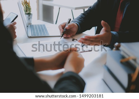 lawyer insurance broker consulting giving legal advice to couple customer about buying renting house. financial advisor with mortgage loan investment contract. realtor selling real estate property