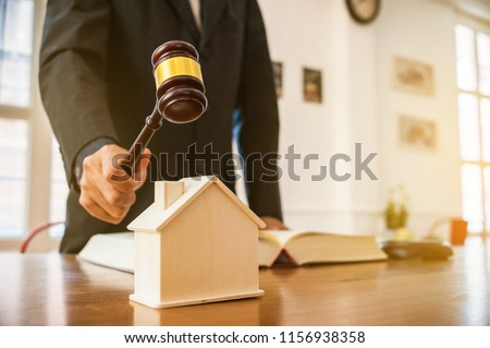 lawyer mediating in a property dispute .Auctioneer knocking down a property sale.Real estate sale auction concep.