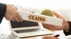 Lawyers filed a claims document of the customer to the insurance company.  insurance claim concept.