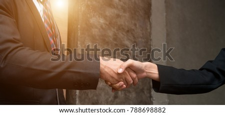 Lawyers handshake,Attorneys from a law firm provide confidence to clients and promise to win cases,Justice Legal Concepts,Lawyer from Law firms with Justice Legal Concepts.Clients is trust in team.