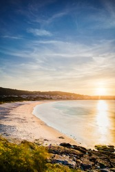 Laxe Beach summer background with copy space of Galician Landscape dusk on the coast. Atlantic ocean sunrise in the death coast nature of Corunna