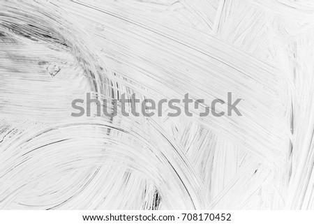 Layer of white paint on glass wall, background photo texture