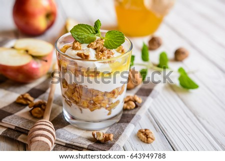 Layered apple dessert with ricotta, walnut, cinnamon and honey in a glass jar