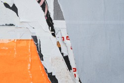 Layered colourful creative urban paper texture out of torn weathered street posters