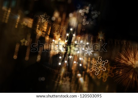 Layered star background of star shaped street lights, star garlands, different star shapes and star bokeh in a depth of field composition