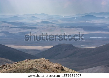 Layers and layers of mountains stretching endlessly to the horizon, captured in Syunik region of Armenia #1559351207