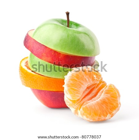 Layers of apples and oranges with slice of tangerine isolated on white background