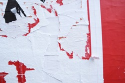 Layers of ripped off wall posters, torn street billboard posters