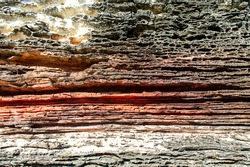 Layers of sedimentary sandstone rock. rock formations in red, white and gray. structure background