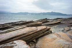 layers of tilted sedimentary rock (shale), in Tung Ping Chau, Hong Kong