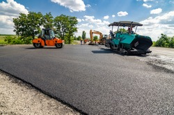 Laying a new asphalt on the road. Construction of the road.