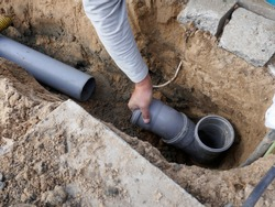 Laying and installation of a  sewer pipe