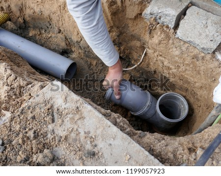 Photo of  Laying and installation of a  sewer pipe