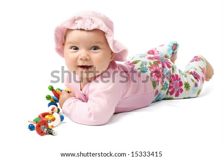 Laying baby in pink clothes on white background