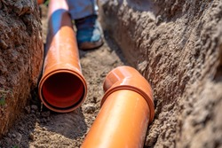 laying drainage pipes into the ground