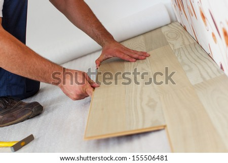 Laying Laminate Flooring In A Home.