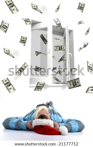laying man christmas hat watching three dimensional flying dollars out of a window - stock photo
