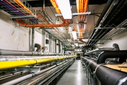 Laying of engineering networks. Ventilation pipes. Air conditioning of buildings. Pipe installation. Technical floor. Maintenance of cable networks.