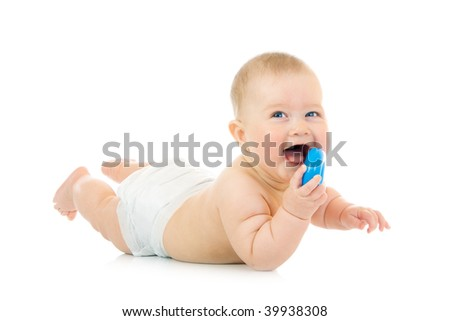 Laying small baby with a toy isolated - stock photo