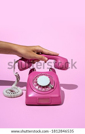 Layout made of pink telephone on blue background. Retro vintage 60's and 70's aesthetic with summer shadows. Flat lay. Stockfoto ©