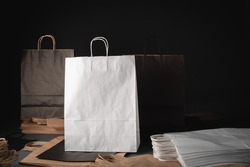 Layout of clean shopping bags. Concept for sales or discounts. Recycled paper. Dark background. Gift paper bags for the holidays - Christmas, Black Friday.