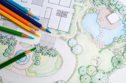 layout plan of home landscape design or garden design drawing by color pencil on white paper and group of color pencils