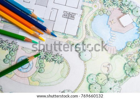 layout plan of home landscape design or garden design drawing by color pencil on white paper and group of color pencils  #769660132