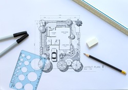 layout plan of  landscape design or garden design or landscape architecture, rough sketching with black pen, pencil, circle template ruler, scale ruler and other tools on white paper, selective focus