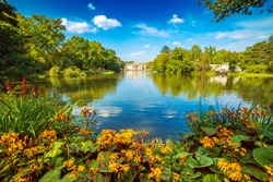 Lazienki Park - Baths Park or Royal Baths also rendered Royal Baths Park is the largest park in Warsaw, Poland. Beautiful lake with flowers.