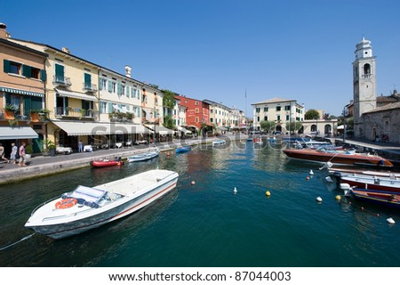 LAZISE - AUG 15: The beautiful and romantic harbor of Lazise at the Lake Garda on August 18, 2011 in Italy. Lazise is one of the most popular cities visited by tourists in the summer.