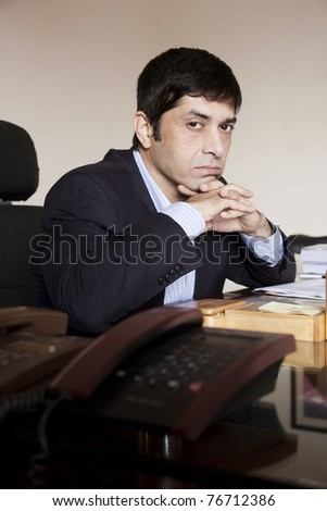 lazy businessman thinking in his office